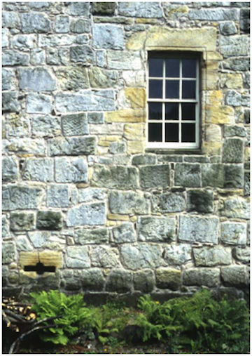 Illus 14: The Gun-Loop and 17th Century Window in the south wall of the main block at Castlecary Castle.  Note the broached Roman stones.